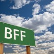 Stock Photo: BFF Green Road Sign Over Sky