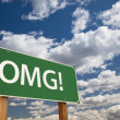 Stock Photo: OMG! Green Road Sign Over Sky