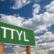 Stock Photo: TTYL Green Road Sign Over Sky