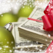 Stack of Hundred Dollar Bills with Bow Near Christmas Ornaments — ストック写真