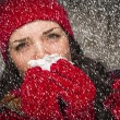 Stock Photo: Sick WomBlowing Her Sore Nose With Tissue and Snow