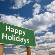 Stock Photo: Happy Holidays Green Road Sign Over Clouds and Sky