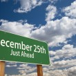 Stock Photo: December 25th Just Ahead Green Road Sign Over Sky