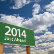 2014 Just Ahead Green Road Sign Over Clouds and Sky — Stock Photo