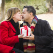 Mixed Race Couple Sharing Christmas or Valentines Day Gift Outsi — Stock Photo #36901457