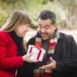 Mixed Race Couple Sharing Christmas or Valentines Day Gift Outsi — Stock Photo #36901467