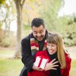 Mixed Race Couple Sharing Christmas or Valentines Day Gift Outsi — Stock Photo #36901499