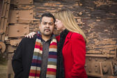 Mixed Race Couple Portrait in Winter Clothing Against Rustic Tra — Stock Photo