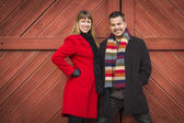 Mixed Race Couple Portrait in Winter Clothing Against Barn Door — Stock Photo