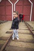 Mixed Race Boy at Train Depot with Parents Smiling Behind — Stock Photo