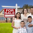 Stock Photo: Hispanic Family, New Home and For Sale Real Estate Sign