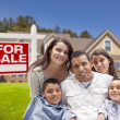 Hispanic Family, New Home and For Sale Real Estate Sign — Zdjęcie stockowe