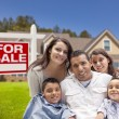 Hispanic Family, New Home and For Sale Real Estate Sign — Stock fotografie