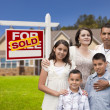 Hispanic Family, New Home and Sold Real Estate Sign — Стоковое фото