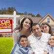 Hispanic Family, New Home and Sold Real Estate Sign — Stock Photo