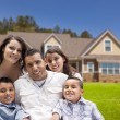 Foto Stock: Young Hispanic Family in Front of Their New Home