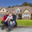 Mixed Race Family in Front of Their New Home — Stock Photo