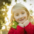 Little Girl Wearing Winter Coat and Scarf at the Park — Stock Photo