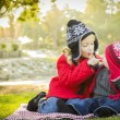Little Girl with Baby Brother Wearing Coats and Hats Outdoors — Stock Photo