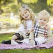 Sweet Little Girl Hugs Her Baby Brother at the Park — Stock Photo
