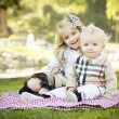 Stock Photo: Sweet Little Girl with Her Baby Brother at the Park