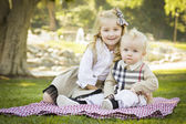 Sweet Little Girl with Her Baby Brother at the Park — Stock Photo