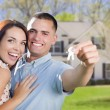 Military Couple with House Keys In Front of New Home — Stock Photo #37610125