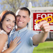 Military Couple In Front of Home, House Keys and Sign — Stock Photo #37610155