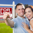 Military Couple In Front of Home, House Keys and Sign — Stock Photo #37610169