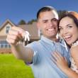 Stock Photo: Military Couple with House Keys In Front of New Home