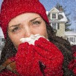 Stock Photo: Sick WomIn Snow Blowing Her Sore Nose With Tissue