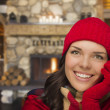 Stock Photo: Mixed Race Girl Enjoying Warm Fireplace In Rustic Cabin
