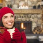 Mixed Race Girl Enjoying Warm Fireplace and Holding Mug — Stock Photo