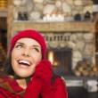 Mixed Race Girl Enjoying Warm Fireplace In Rustic Cabin — Stock Photo #37684667