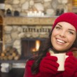 Mixed Race Girl Enjoying Warm Fireplace and Holding Mug — Stok fotoğraf