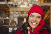 Mixed Race Girl Enjoying Warm Fireplace In Rustic Cabin — Stock Photo