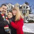 Mixed Race Family in Front of House in The Snow — Stock Photo
