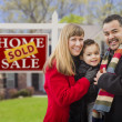Stock Photo: Family in Front of Sold Real Estate Sign and House