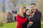 Happy Mixed Race Family in Front of House — Stock Photo