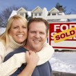 Couple in Front of New House and Real Estate Sign — Stock Photo #37880425