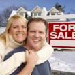 Couple in Front of New House and Real Estate Sign — Stock Photo #37880443