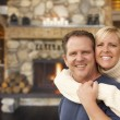 Stock Photo: Affectionate Couple at Rustic Fireplace in Log Cabin