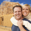 Couple in Front of New Home Construction Framing Site — Stock Photo
