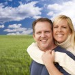 Happy Attractive Couple Hugging at the Park — Stock Photo #37880479