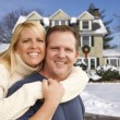 Couple in Front of Beautiful House with Snow on Ground — Foto Stock