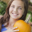 Pretty Young Girl Having Fun with the Pumpkins at Market — Stock Photo #38040823