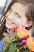 Pretty Young Girl Holding Flower Bouquet at the Market — Stock fotografie