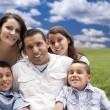 Hispanic Family Portrait Sitting in Grass Field — Stock Photo
