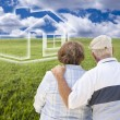 Senior Couple Standing in Grass Field Looking at Ghosted House — Stock Photo