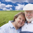 Loving Senior Couple Standing in Grass Field — Stock Photo